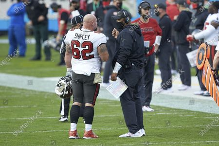 Stock Photo of Tampa Bay Buccaneers center A.Q. Shipley (62) chats with assistant head coach Harold Goodwin during an NFL football game against the Carolina Panthers, in Charlotte, N.C