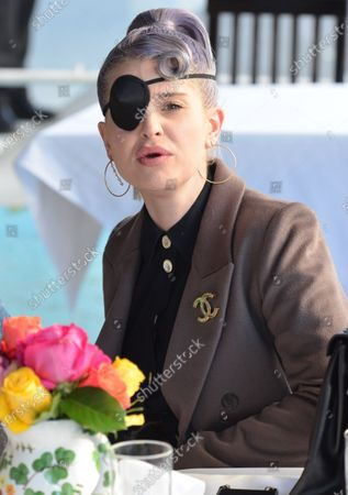 Kelly Osbourne seen wearing an eyepatch while dining at The Ivy in West Hollywood after a makeup-related injury