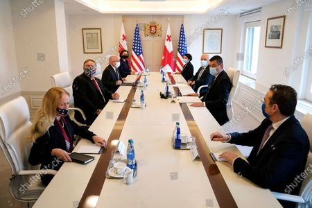 Stock Image of Secretary of State Mike Pompeo, second from left, meets with Georgia's Prime Minister Giorgi Gakharia, second from right, at the Georgian Chancellery in Tbilisi, Georgia, . Also seated are U.S. Ambassador to Georgia Kelly Degnan, clockwise from bottom left, Ambassador Philip Reeker, Bureau of European and Eurasian Affairs, Mary Kissel, senior advisor to Secretary Pompeo, Natia Sulava, acting Head of Administration of the President of Georgia, Georgia's Foreign Minister David Zalkaliani and David Bakradze, Georgian Ambassador to the United States