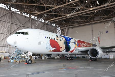 Editorial photo of Japan Airlines special designed plane to celebrate 80th anniversary of Disney's animated film Fantasia is displayed, Tokyo, Japan - 18 Nov 2020