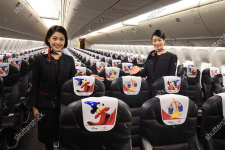 "Japan Airlines' (JAL) cabin attendants display special designed headrest covers in a special designed airplane to celebrate the 80th anniversary of Walt Disney's animated film ""Fantasia"" which had the first screening in 1940 at a JAL hangar at Tokyo's Haneda airport on Wednesday, November 18, 2020. The special designed plane ""JAL Dream Express Fantasia 80"" is provided for a chartered pleasure flight on November 18 then served into domestic flights."