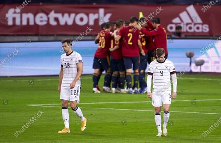 Leon Goretzka and Timo Werner of Germany react during the UEFA Nations League group stage match between Spain and Germany at Estadio de La Cartuja on November 17, 2020 in Seville, Spain.