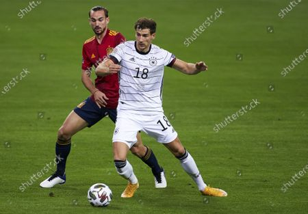 Fabian Ruiz of Spain competes for the ball with Leon Goretzka of Germany during the UEFA Nations League group stage match between Spain and Germany at Estadio de La Cartuja on November 17, 2020 in Seville, Spain.