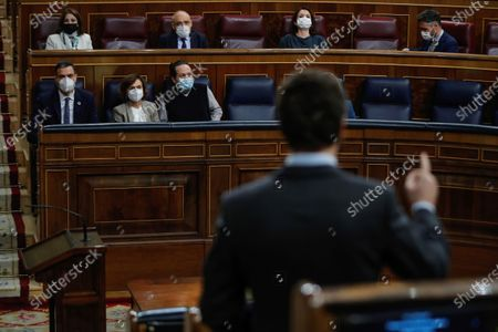 Spanish Prime Minister, Pedro Sanchez (L), first deputy Prime Minister Carmen Calvo (2L) and second deputy Prime Minister Pablo Iglesias (3L) listen the intervention of the leader of Spanish People's Party, Pablo Casado (back to camera), during question time at the Lower House in Madrid, Spain, 18 November 2020. The Spanish Government is to answer MPs on various issues including the national 2021 budget bill.
