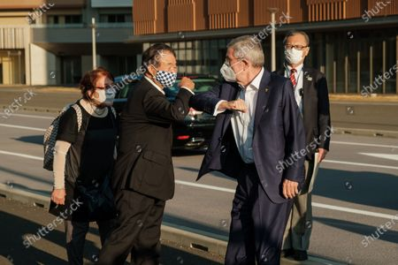 International Olympic Committee president Thomas Bach (2nd R) wearing a face mask greets Endo Toshiaki (2nd L), vice president of Tokyo 2020, during a visit of Olympic and Paralympic village in Tokyo, Japan, on Nov. 17, 2020.