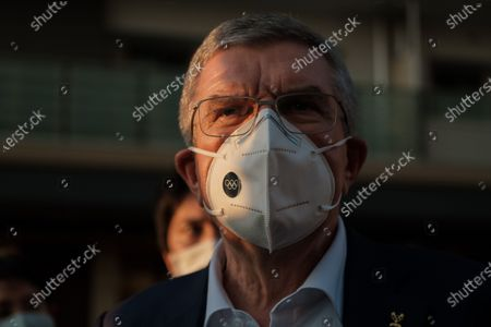 International Olympic Committee president Thomas Bach wearing a face mask talks to journalists during a visit of Olympic and Paralympic village in Tokyo, Japan, on Nov. 17, 2020.