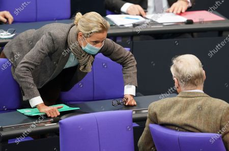 Alternative for Germany party (AfD) faction co-chairwoman in the German parliament Bundestag and deputy chairwoman Alice Weidel (L) speaks with AfD faction co-chairman Alexander Gauland (R) during the debate on the 3rd reform of the law for the protection of the population in the event of an epidemic situation of national scope at the German parliament Bundestag, in Berlin, Germany, 18 November 2020. The infection protection law regulates measures during a pandemic such as the current spread of the Covid-19 dIsease.