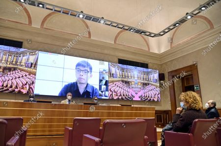(L-R) Toni Iwobi. senator of Lega, Adolfo Urso, senator of Fratelli d'Italia and president of Farefuturo Foundation, and Laura Hart, Nonviolent Radical Party Transnational Transparty (PRNTT), attends a video-conference lesson on liberty leaded by the Hong Kong student activist and politician Joshua Wong (on screen) and organized by Farefuturo Foundation in the Nassirya Hall of the Senate, Rome, Italy, 18 November 2020.