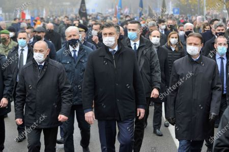 Stock Photo of Croatia's Prime Minister Andrej Plenkovic, center, takes part in a commemoration march in Vukovar, Croatia, . Some thousands marched to commemorate the suffering of Croatia's eastern city of Vukovar during the 1991-95 war despite a continuously high number of infection and fatalities from the new coronavirus