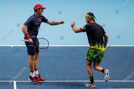 Michael Venus of New Zealand, right, celebrate a winning point with John Peers of Australia, as they play against Jurgen Melzer of Austria during their tennis match at the ATP World Finals tennis tournament at the O2 arena in London