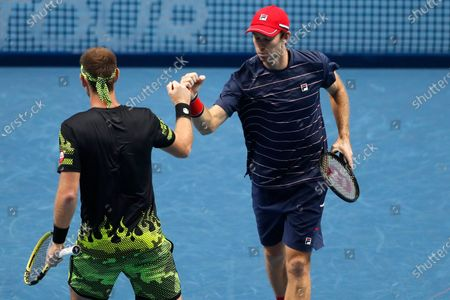Michael Venus of New Zealand, left, celebrate a winning point with John Peers of Australia, as they play against Jurgen Melzer of Austria and Edouard Roger-Vasselin of France during their tennis match at the ATP World Finals tennis tournament at the O2 arena in London
