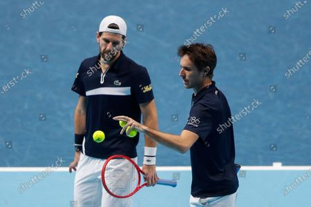 Edouard Roger-Vasselin of France, right, is flanked by Jurgen Melzer of Austria as they play against Michael Venus of New Zealand and John Peers of Australia during their tennis match at the ATP World Finals tennis tournament at the O2 arena in London