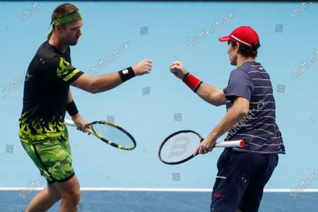 Michael Venus of New Zealand, left, celebrates a winning point with John Peers of Australia, as they play against Jurgen Melzer of Austria and Edouard Roger-Vasselin of France during their tennis match at the ATP World Finals tennis tournament at the O2 arena in London
