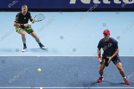 Michael Venus of New Zealand, left, and John Peers of Australia, play a return to Jurgen Melzer of Austria and Edouard Roger-Vasselin of France during their tennis match at the ATP World Finals tennis tournament at the O2 arena in London