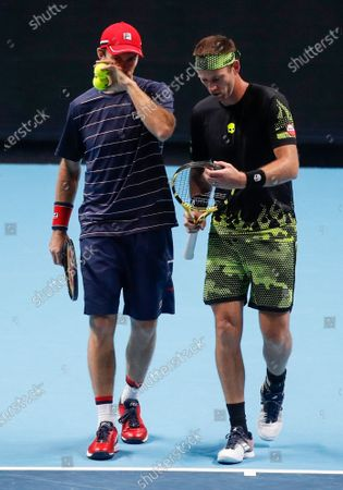 Michael Venus of New Zealand, right, is flanked by John Peers of Australia, as they play against Jurgen Melzer of Austria and Edouard Roger-Vasselin of France during their tennis match at the ATP World Finals tennis tournament at the O2 arena in London