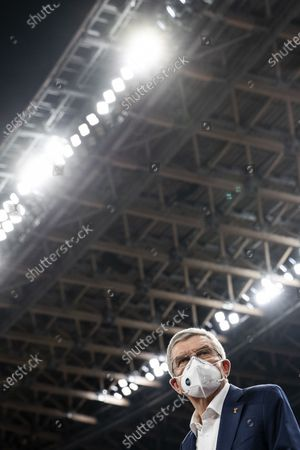 International Olympic Committee (IOC) president Thomas Bach wearing a face mask speaks to media during his visit at the National Stadium, main venue for the 2020 Olympic and Paralympic Games postponed until July 2021 due to the COVID-19 coronavirus pandemic