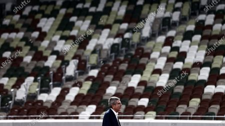 International Olympic Committee (IOC) president Thomas Bach poses for the official cameramen during his visit at the National Stadium, main venue for the 2020 Olympic and Paralympic Games postponed until July 2021 due to the COVID-19 coronavirus pandemic