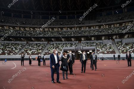 International Olympic Committee (IOC) president Thomas Bach wearing a face mask visits the National Stadium, main venue for the 2020 Olympic and Paralympic Games postponed until July 2021 due to the COVID-19 coronavirus pandemic