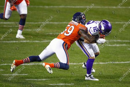 Minnesota Vikings wide receiver Chad Beebe (12) is tackled by Chicago Bears inside linebacker Danny Trevathan (59) during the first half of an NFL football game, in Chicago