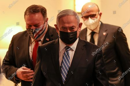 (L to R) US Secretary of State Mike Pompeo, Israeli Prime Minister Benjamin Netanyahu, and Bahrain's Foreign Minister Abdullatif bin Rashid Al Zayani, all mask-clad due to the COVID-19 coronavirus pandemic, arrive for a press conference after their trilateral meeting