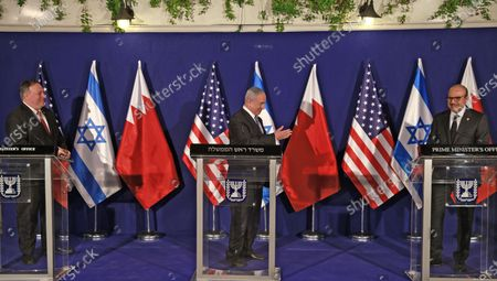 (L to R) US Secretary of State Mike Pompeo and Israeli Prime Minister Benjamin Netanyahu look towards Bahrain's Foreign Minister Abdullatif bin Rashid Al Zayani as he speaks during a press conference after their trilateral meeting