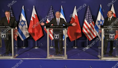 (L to R) US Secretary of State Mike Pompeo looks on while Israeli Prime Minister Benjamin Netanyahu gestures as Bahrain's Foreign Minister Abdullatif bin Rashid Al Zayani looks towards Netanyahu, during a press conference after their trilateral meeting
