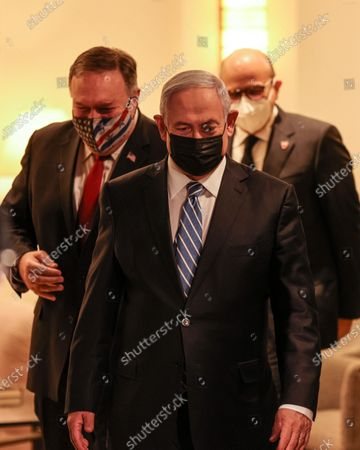 Stock Image of (L to R) US Secretary of State Mike Pompeo, Israeli Prime Minister Benjamin Netanyahu, and Bahrain's Foreign Minister Abdullatif bin Rashid Al Zayani, all mask-clad due to the COVID-19 coronavirus pandemic, arrive for a press conference after their trilateral meeting