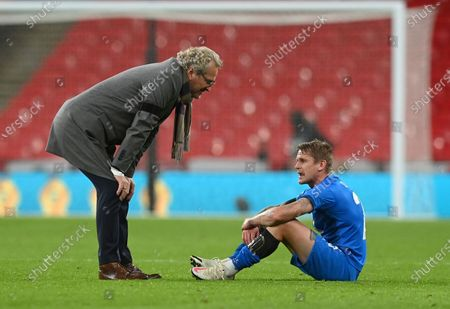 Stock Image of Iceland's Ari Skulason speaks with Iceland coach Erik Hamren after the UEFA Nations League soccer match between England and Iceland at Wembley stadium in London