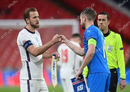 Stock Picture of England's Harry Kane, left, and Iceland's Kari Arnason greet each other before the UEFA Nations League soccer match between England and Iceland at Wembley stadium in London