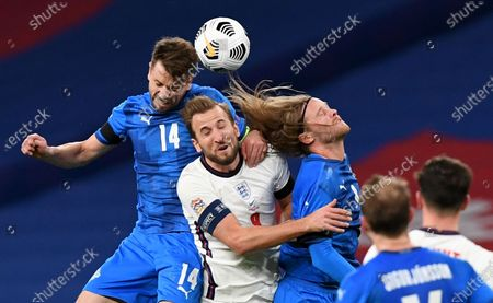 Harry Kane (C) of England in action against Icelandic players Kari Arnason (L) and Birkir Bjarnason (R) during the UEFA Nations League soccer match between England and Iceland in London, Britain, 18 November 2020.