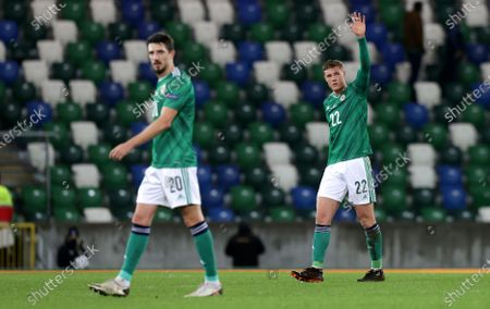 Craig Cathcart (L) and Daniel Ballard of Northern Ireland walk off the pitch after the UEFA Nations League match between Northern Ireland and Romania in Belfast, Britain, 18 November 2020.