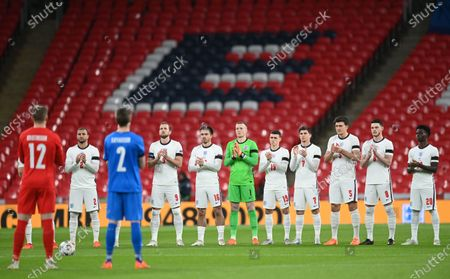 England players applaud in memory of late England goalkeeper Ray Clemence prior to the UEFA Nations League soccer match between England and Iceland in London, Britain, 18 November 2020.
