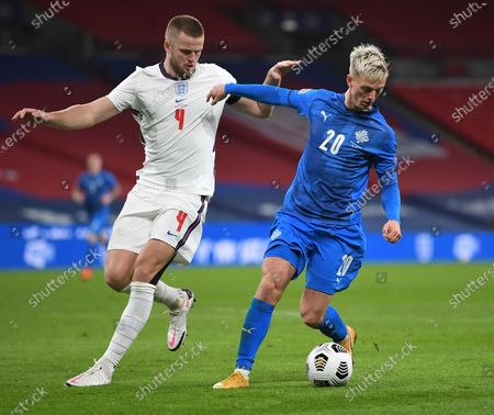Eric Dier (L) of England in action against Albert Gudmundsson (R) of Iceland during the UEFA Nations League soccer match between England and Iceland in London, Britain, 18 November 2020.