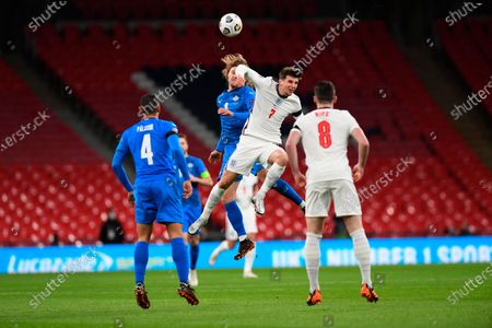 Iceland's Birkir Bjarnason, left, fights for the ball with England's Mason Mount during the UEFA Nations League soccer match between England and Iceland at Wembley stadium in London