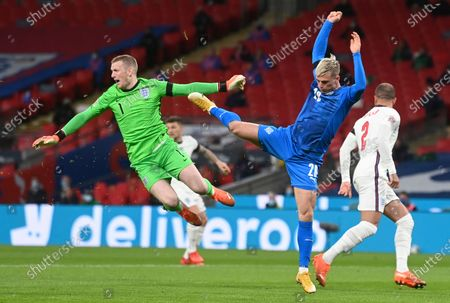 Iceland's Albert Gudmundsson, rights fights with England's goalkeeper Jordan Pickford, left, during the UEFA Nations League soccer match between England and Iceland at Wembley stadium in London