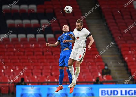 Stock Picture of Iceland's Sverrir Ingason, left, fights for the ball with England's Harry Kane during the UEFA Nations League soccer match between England and Iceland at Wembley stadium in London