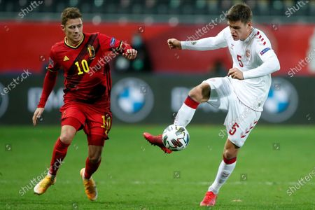 Belgium's Thorgan Hazard, left, vies for the ball with Denmark's Joakim Mæhle during the UEFA Nations League soccer match between Belgium and Denmark at the King Power stadium in Leuven, Belgium