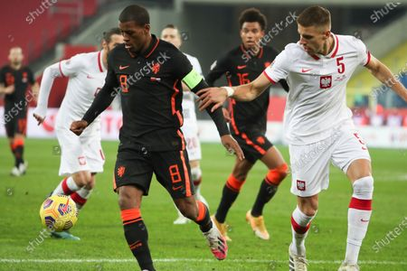 Netherlands' Georginio Wijnaldum, left, and Poland's Jan Bednarek vie for the ball during the Nations League soccer match between Poland and The Netherlands at Silesian Stadium in Chorzow, Poland