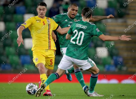 Northern Ireland vs Romania. Northern Ireland's Josh Magennis and Craig Cathcart with Romania's Ionut Nedelcearu