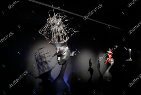 The hat creation 'The Ship Hat' (L) by Irish hat designer Philip Treacy is on display during a press preview of the exhibition 'Philip Treacy. The Maestro' at the Erarta Museum in St. Petersburg, Russia, 18 November 2020. The exhibiton dedicated to the Haute Couture milliner opens to the public from 20 November 2020 to 21 March 2021.