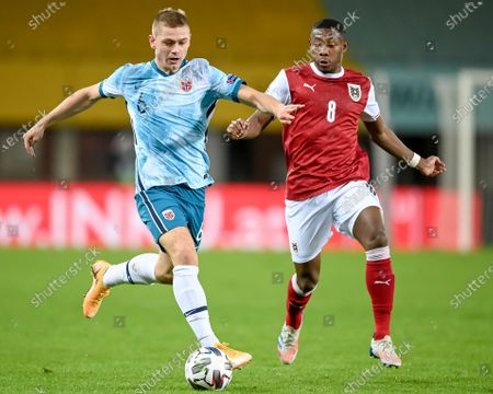 Stock Photo of Julian Ryerson of Norway (L) and David Alaba of Austria (R) in action during the UEFA Nations League League group B1 soccer match between Austria and Norway in Vienna, Austria, 18 November 2020.
