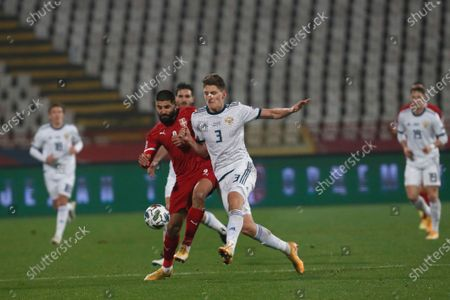 Serbia's Dusan Vlahovic, left, challenges for the ball with Russia's Igor Smolnikov during the UEFA Nations League soccer match between Serbia and Russia at the Rajko Mitic Stadium, in Belgrade, Serbia