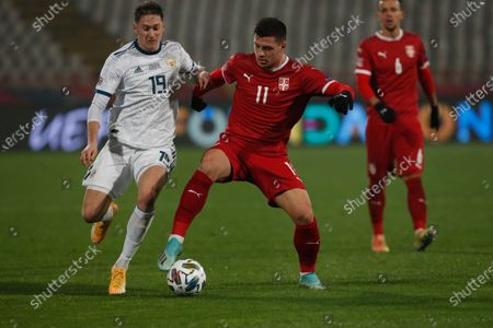 Serbia's Luka Jovic right, challenges for the ball with Russia's Aleksandr Sobolev during the UEFA Nations League soccer match between Serbia and Russia at the Rajko Mitic Stadium, in Belgrade, Serbia