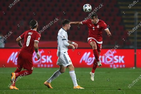 Serbia's Uros Spajic, right, jumps from a header during the UEFA Nations League soccer match between Serbia and Russia at the Rajko Mitic Stadium, in Belgrade, Serbia