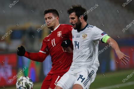 Serbia's Luka Jovic, left, fights for the ball with Russia's Andrei Mostovoy during the UEFA Nations League soccer match between Serbia and Russia at the Rajko Mitic Stadium, in Belgrade, Serbia