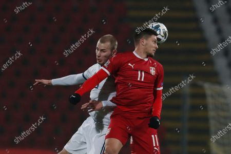 Serbia's Luka Jovic, right, challenges for a header with Russia's Andrei Semenov during the UEFA Nations League soccer match between Serbia and Russia at the Rajko Mitic Stadium, in Belgrade, Serbia