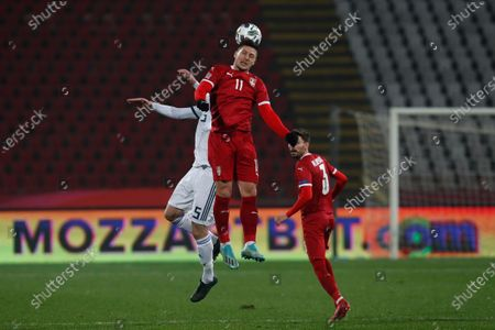Serbia's Luka Jovic, center challenges for a header with Russia's Andrei Semenov during the UEFA Nations League soccer match between Serbia and Russia at the Rajko Mitic Stadium, in Belgrade, Serbia