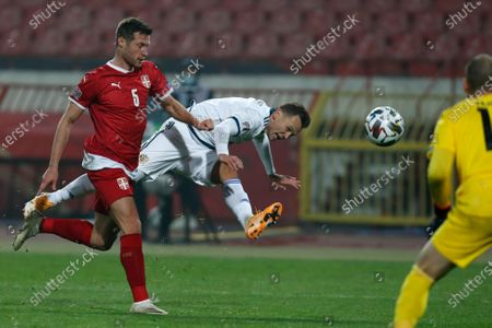 Russia's Denis Cheryshev, center tries to score next to Serbia's Uros Spajic, left, during the UEFA Nations League soccer match between Serbia and Russia at the Rajko Mitic Stadium, in Belgrade, Serbia