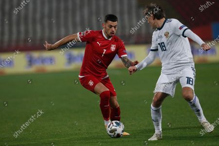 Stock Image of Serbia's Nemanja Radonjic,left, is challenged by Russia's Yuri Zhirkov, before he scores the opening goal of the match against Russia during the UEFA Nations League soccer match between Serbia and Russia at the Rajko Mitic Stadium, in Belgrade, Serbia