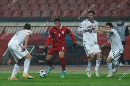 Stock Image of Russia's Roman Zobnin second left, is challenged by Russia's Igor Smolnikov left, during the UEFA Nations League soccer match between Serbia and Russia at the Rajko Mitic Stadium, in Belgrade, Serbia